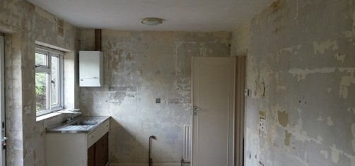 You can see the kitchen here with the units and tiles removed.